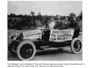 """The """"Pathfinder"""" car of Ed Fletcher (2ndfrom left). The three other men are Harry Taylor, Wilson Smith, andF. L. Hamilton. October 1912. Special Collections, University of California, San Diego."""
